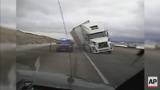 Raw: Big Rig Blows Over, Crushes Patrol Car